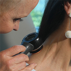 Medical Dermatology - Doctor inspecting neck area